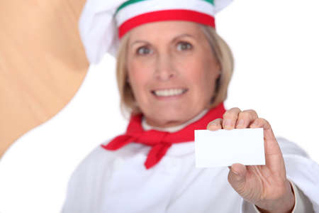 senior chef holding a business card photo