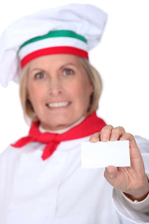 specialities: Italian chef with a blank business card Stock Photo