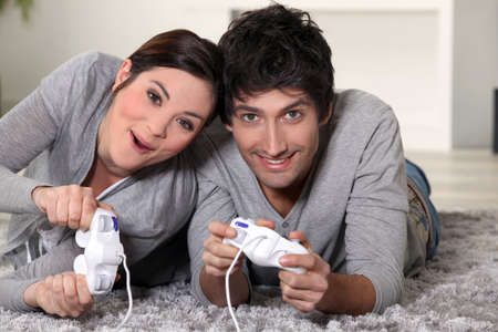 game room: couple playing video games
