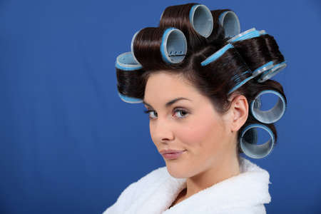 curlers: woman with hair curlers pouting
