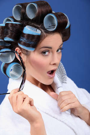 curlers: woman with curlers wearing sunglasses Stock Photo