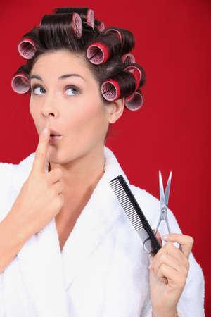 hair curler: Woman in bath robe wearing hair rollers