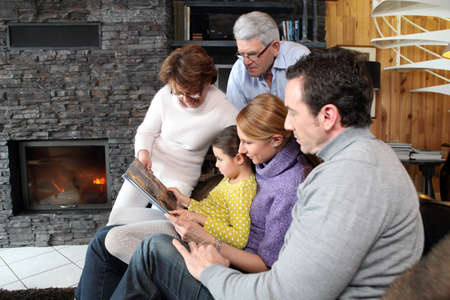 Family at home around a fireplace