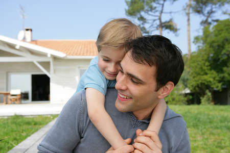 buying a house: Father and son in the garden