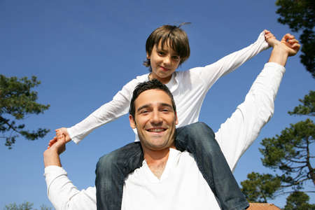 Man carrying his son on his shoulders Stock Photo - 14106717
