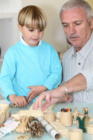 examples: Grandfather spending quality time with his grandson Stock Photo