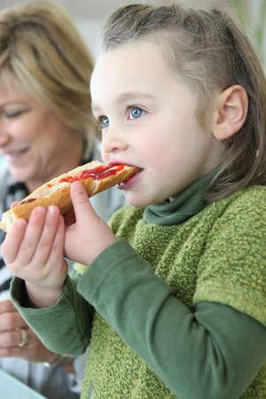 Little girl eating jam on toast for breakfast Stock Photo - 14113705