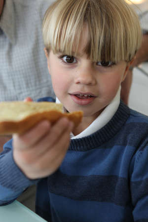 Boy with slice of bread photo