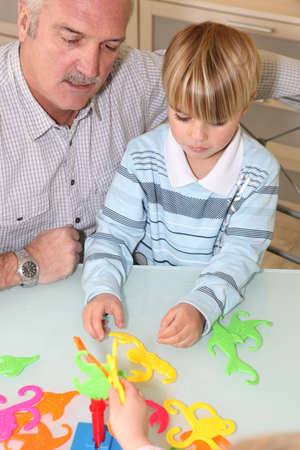 Grandfather playing with grandson Stock Photo - 14113788