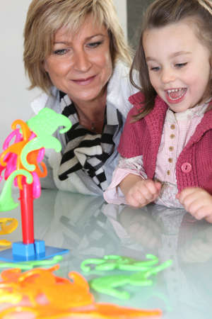 Mother and daughter playing a game photo