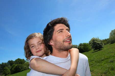 shoulder ride: Man giving daughter piggyback