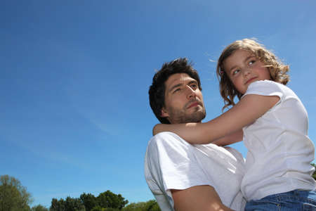 Father and daughter in summer