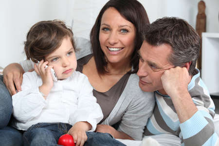 spouses: Happy young family sat together Stock Photo