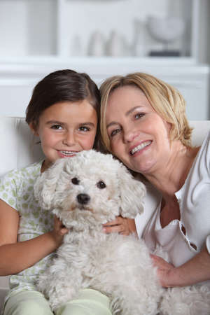 Mother, daughter and dog photo