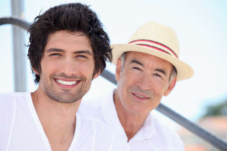 younger: Father and son on holiday together Stock Photo