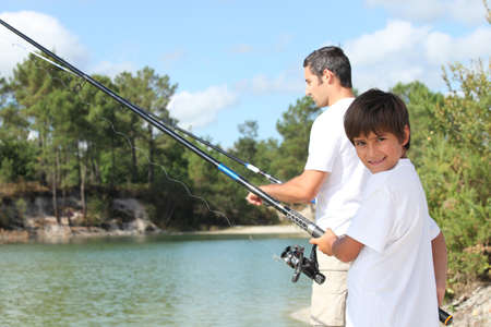Father and son fishing together in the summertime photo