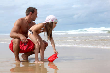 playing in the sea: Father and daughter at the seaside