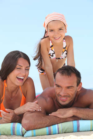 suntanning: Family on vacation together Stock Photo