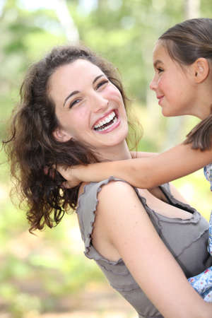 correlated: Mother and daughter in her arms Stock Photo