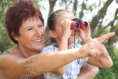 Grandmother with granddaughter and binoculars Stock Photo - 14111830