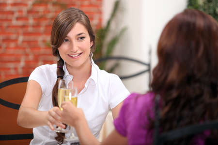 conviviality: portrait of a young woman at restaurant