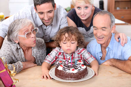 big family: Family celebrating birthday boy