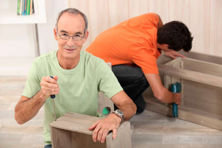 Father and son building furniture photo