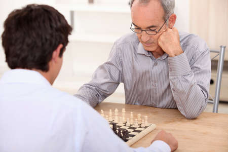 chess game: People playing chess Stock Photo