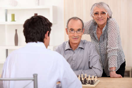 Grownup family playing chess Stock Photo - 14111514