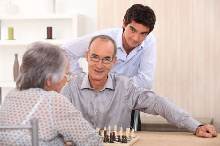 Grandparents playing chess Stock Photo - 14110798