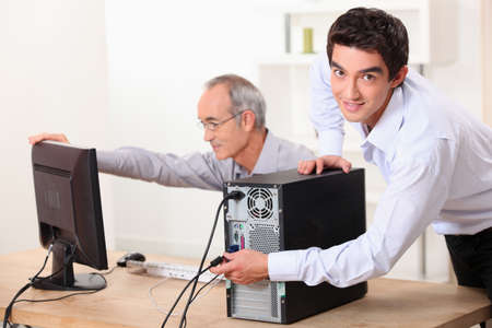 Two men with a computer Stock Photo - 14110627