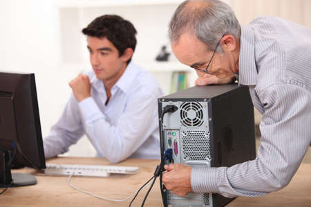 vision repair: Grandfather installing computer Stock Photo
