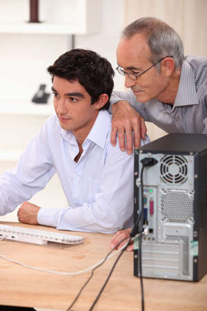 father and son: Father and son on the computer. Stock Photo