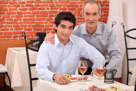 Two generations sitting in a restaurant photo