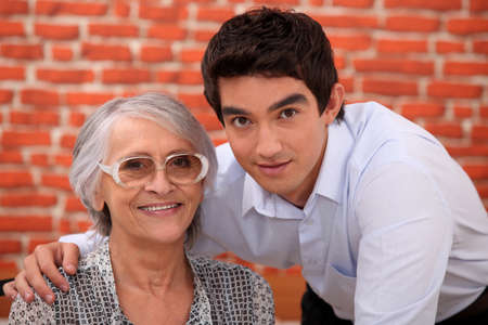 grannies: Grandson and grandmother in restaurant Stock Photo