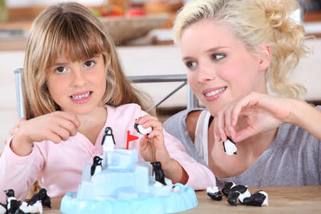 Woman and little girl playing with toys photo