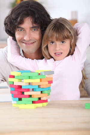 Father with daughter and puzzle Stock Photo - 14111573