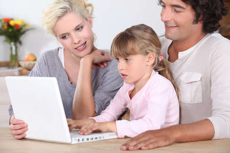 adapted: Parents with daughter and computer