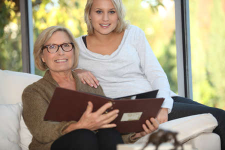 Grandmother and granddaughter looking at pictures photo