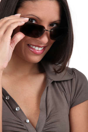 Woman peering over her sunglasses photo