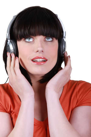 woman listening to music against studio background photo