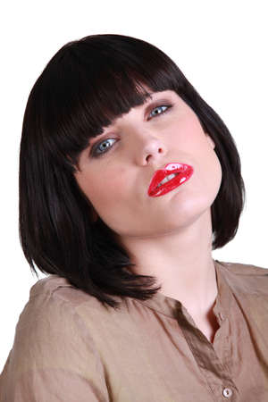 green lipstick: Woman with a smart bob and red lipstick