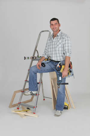 Tradesman posing with his building materials photo