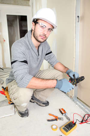 Electrician wiring up a home photo