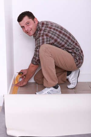 Man laying new carpenter photo