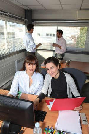 get across: Co-workers in office