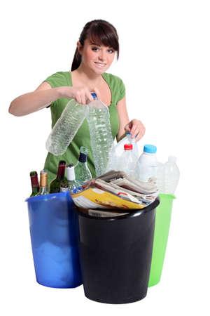 sorting: Woman sorting recycling Stock Photo