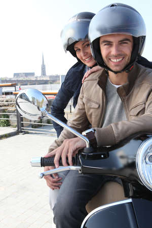 new motor vehicles: Young couple having a motorbike ride