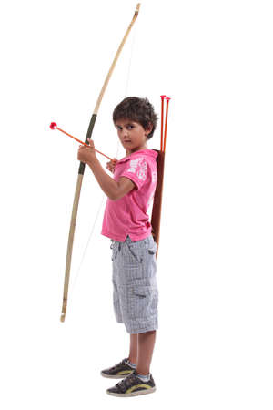 Young boy with a large bow and arrow photo
