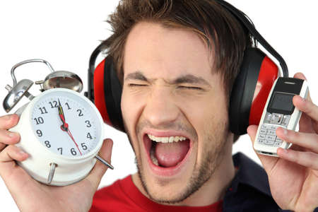 oversleep: Man screaming at his alarm clock